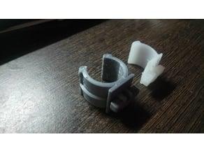 Tube holder for washing machine