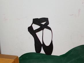 classical dancer figurine and siren