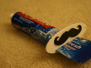 Mustache toothpaste squeezer!