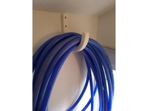Big hook, wall mounted, for hose, extension cord, etc.