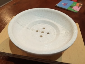 Round soap dish with drain holes