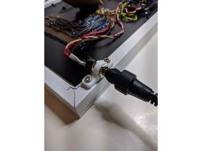 Female power supply plug support