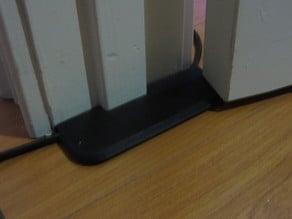 Extension cord under-door pass-thru protector