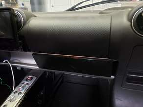 tesla roadster (possibly lotus elise) glove compartment