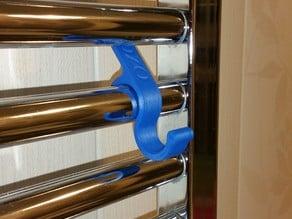 Hanger for towel radiators