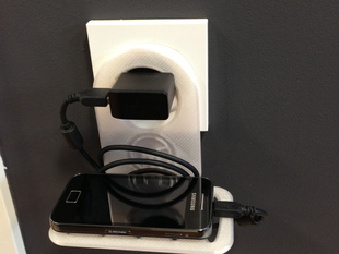 Support for charging mobile phones at any plug