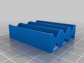 Battery holder for three AAA cells