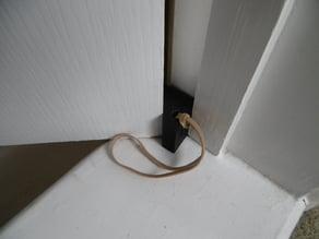 In-hinge door stop