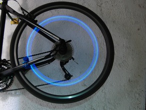 Bike wheel induction safety light