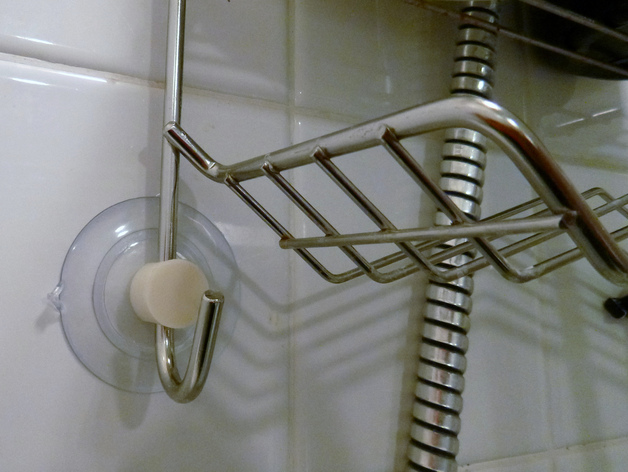 Shower caddy suction cup retainer