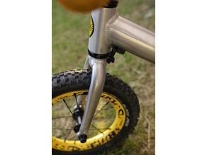 steering damper clamp for a Kokua Jumper balance bike - cable routing option