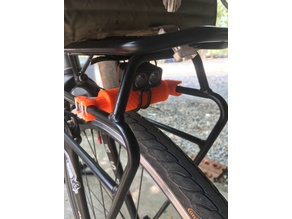 flashlight adapter under rack touring bike