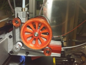 Belt driven and feeding extruder