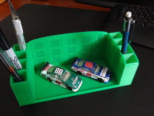 Pen holder with room for collectable