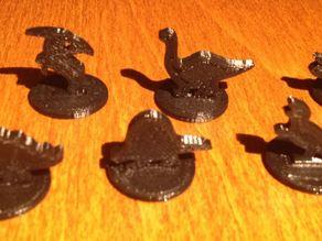 Small Dinosaur game pieces