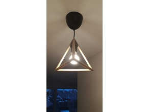 Tetraeder shaped lamp with a hole