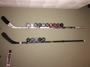 Hockey stick wall mount
