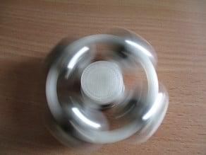 Fidget spinner with balls