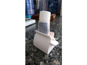 Yet another tooth paste holder and squeezer