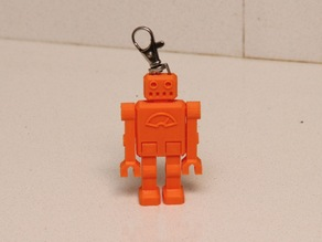 One piece articulated robot keychain with a clip