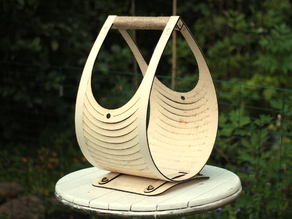 "Teardrop log basket ""Pisara"""