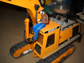 seated man driver w hat for trucks and heavy equipment