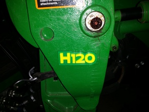 John Deere H120 badge replacement